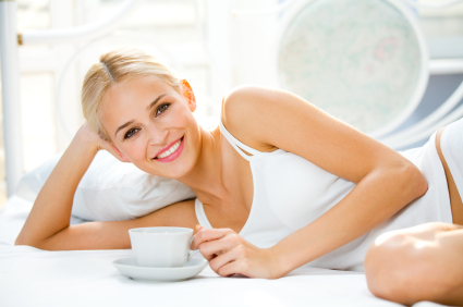 woman on bed drinking coffee