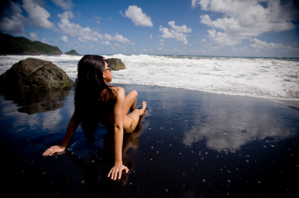 girl in a bikini on black sand beach