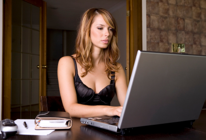 sexy female typing on computer