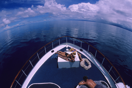 people tanning on a yacht