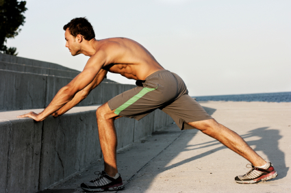 man stretching before running